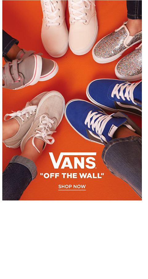 An assortment of Vans kids sneakers.
