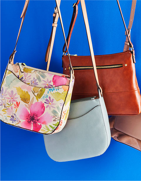 An assortment of handbags in various colors and styles.