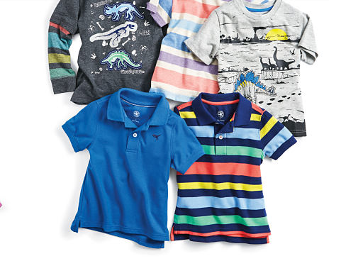 An assortment of boys' polos and T-shirts in various colors and styles.