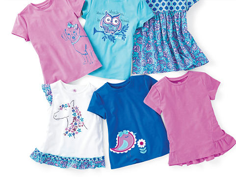 An assortment of girls' tops in a various colors and styles.