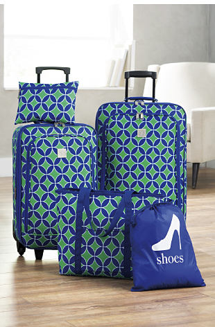 A blue and green patterned five piece luggage set.