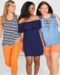 A woman wearing a blue and white striped tank and orange pants, a woman wearing a navy cold shoulder dress and a woman wearing a sleeveless light blue top and salmon shorts.