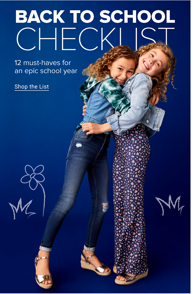 A girl in a green and white tie dye hoodie, denim vest and blue jeans hugs another girls, who wears a denim jacket and loose, flowy pants with a floral pattern. Back to school checklist. Twelve must haves for an epic school year. Shop the list.