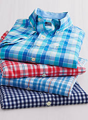 An assortment of plaid button-front shirts in various colors. Shop casual shirts.