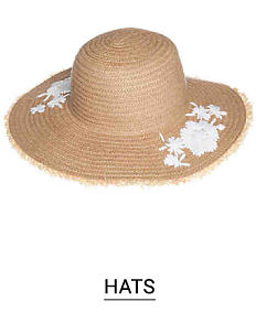 A straw hat with white flower accents. Shop hats.