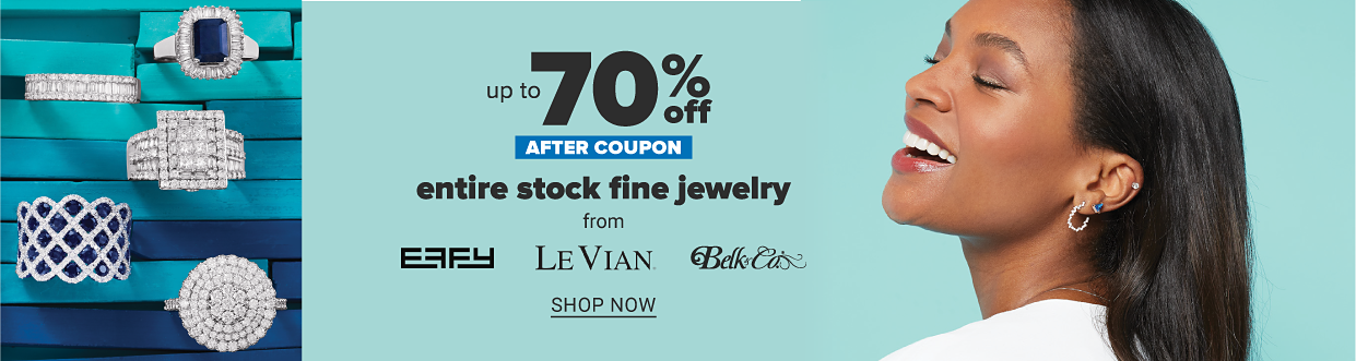Image shows an assortment of rings in white gold with blue stones and diamonds, and a woman smiling and wearing hoop earrings with diamonds and blue stone studs. Up to 70 percent off entire stock fine jewelry from Effy, Le Vian and Belk and Co. Shop now.