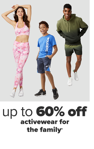 A woman in a pink and white tie dyed matching sports bra and legging set with white sneakers. A little boy in a blue New Balance tee shirt and gray shorts with black sneakers. A man in a light green to dark green gradient matching hoodie and short set with white sneakers. Up to 60% off activewear for the family.