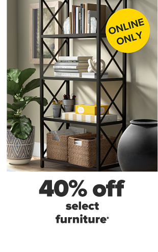 A black shelf in a home setting with various books and other decorative items on it. A fiddle leaf fig tree with a patterned pot. An empty gray pot. Online only! 40% off select furniture.