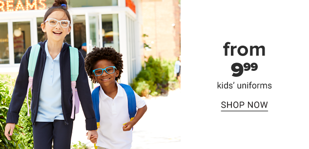 A girl wearing glasses, a navy jacket over a light blue polo, navy pants & a mint green & pink backpack standing next to a boy wearing glasses, a white polo & a blue backpack. From $9.99 kids uniforms. Shop now.