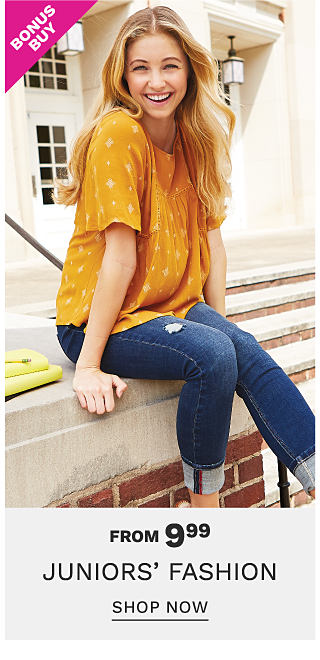 A young woman wearing a gold short sleeved top & blue jeans. Bonus Buy. From $9.99 Juniors Fashion. Shop now.