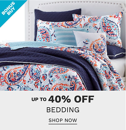 A bed made with a red, white & blue floral print comforter & matching pillows. Bonus Buy. Up to 40% off bedding. Shop now.