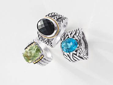 Three silver rings with different colored gemstones.