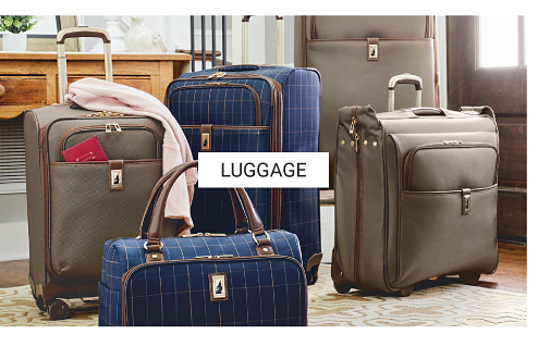 An assortment of luggage in a variety of colors & styles. Shop luggage
