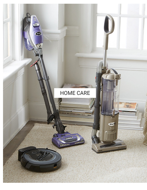 Three different styles of vacuum cleaners. Shop home care.