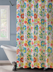 A multicolor floral shower curtain hanging over a clawfoot bathtub. Shop shower curtains.