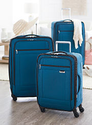 A blue three piece spinner luggage set. Shop spinners.