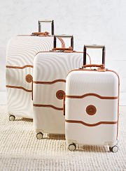 A white and brown three piece hardside luggage set. Shop hardside.