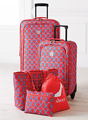 A blue and red patterned five piece luggage set. Shop luggage sets.