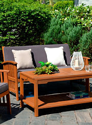 An outdoor couch and outdoor coffee table. Shop patio furniture.