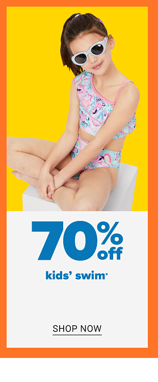 A little girl in a two piece printed bathing suit and sunglasses. 70% off kids' swim. Shop now.