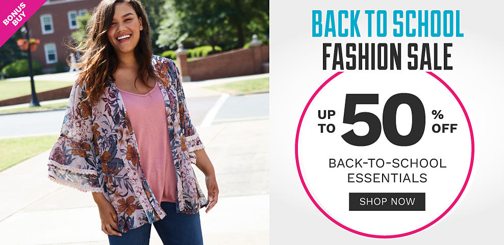 A young woman wearing a multi colored floral print long sleeved oprn front wrap over a pink tee & blue jeans. Back to School Fashion Sale. Bonus Buy. Up to 50% off back to school essentials. Shop now.