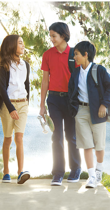 A girl and two boys wearing various styles of school uniforms.