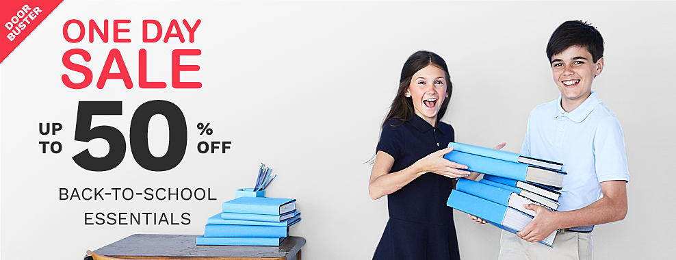 A girl wearing a navy polo & a navy skirt standing next to a boy wearing a light blue polo & beige shorts carrying a stack of books. One Day Sale. Bonus Buy. Up to 50% off back to shool essential.