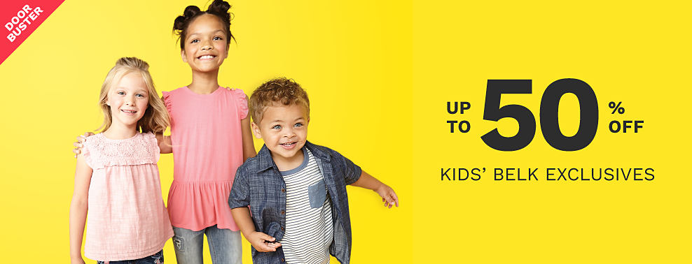 A girl wearing a peach sleeveless top with lace details & blue jeans with floral side detail standing next to a girl wearing a pink sleeveless top & blue jeans & a boy wearing a gray short sleeved button front shirt over a white & denim blue horizontal striped T shirt & beige pants. Bonus Buy. Up to 50% off kids Belk exclusives.