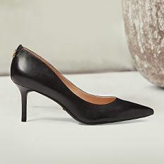 A black high heeled pump. Shop shoes.