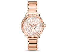 A women's rose gold watch. Shop Michael Kors.