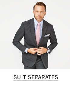 A man in a dark gray suit, light blue shirt and light pink tie. Shop suit separates.
