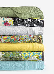 An assortment of colorful quilts. Shop quilts.