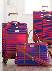 A collection of luggage in a red and blue print. Shop luggage.