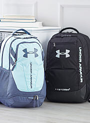 An assortment of black and blue backpacks. Shop backpacks.
