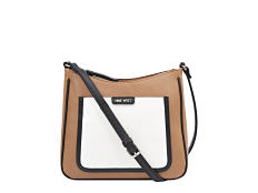 A brown and white colorblock crossbody bag with black trim and strap. Shop crossbody.