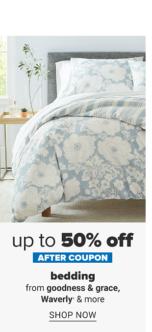 A bed with a blue and white comforter and pillows to match. Up to 50% off, after coupon, bedding from goodness and grace, Waverly and more. Shop now.