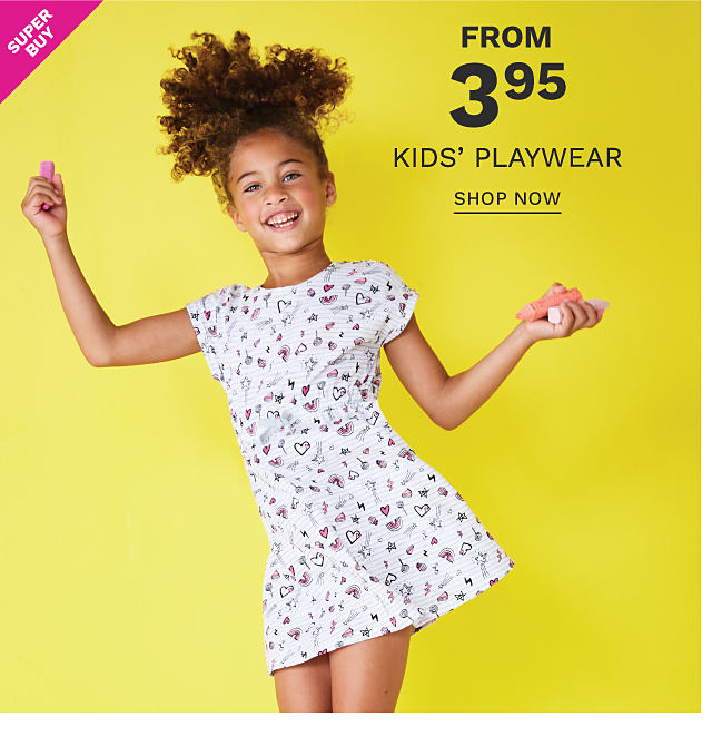 A girl wearing a white short sleeved dress with a multi colored print. Super Buy. From $3.95 kids playwear. Shop now.