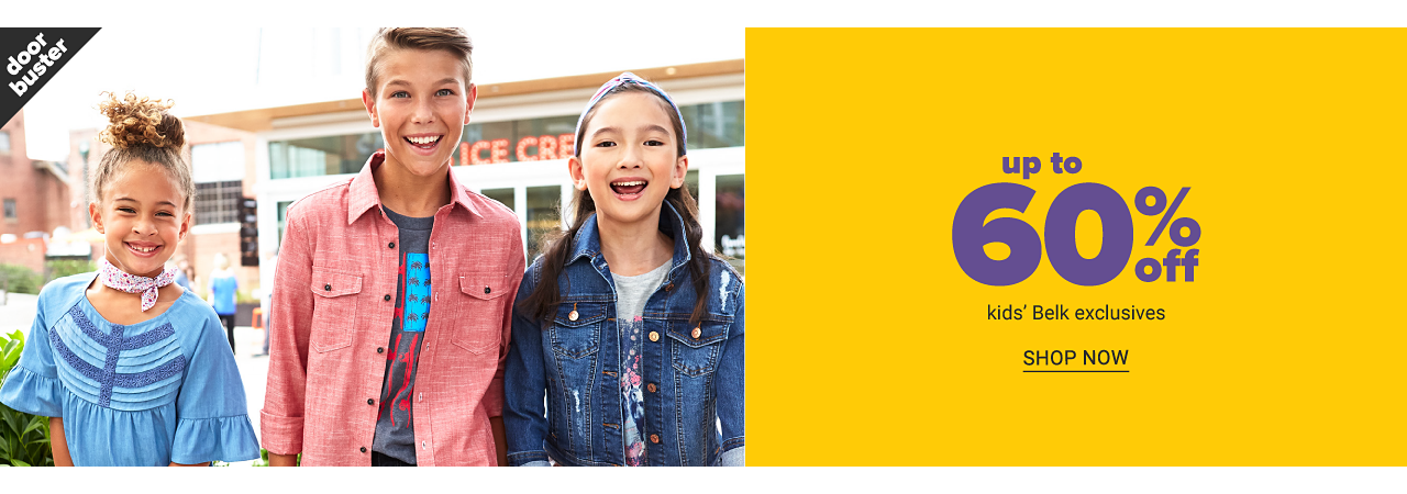 A girl wearing a blue & light blue short sleeved top standing next to a girl wearing a coral long sleeved button front blouse over a gray tee with a red & blue fron graphic & a girl wearing a denim jacket over a gray tee with a blue & red front graphic. Up to 60% off kids' Belk exclusives. Shop now.