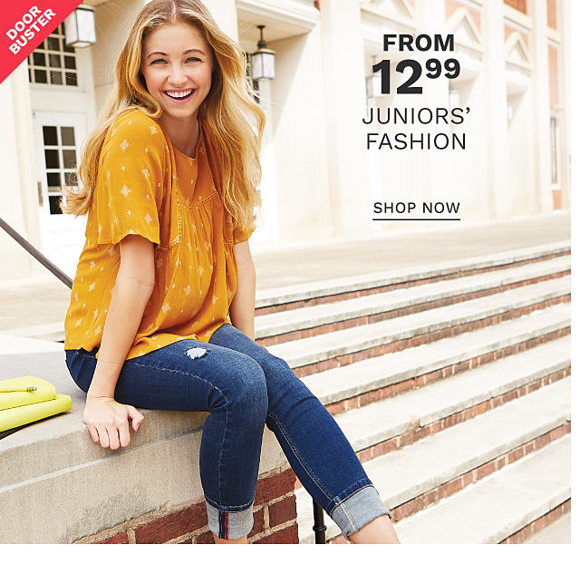 A woman wearing a gold short sleeved top & blue jeans. DoorBuster. From $12.99 juniors fashion. Shop now.