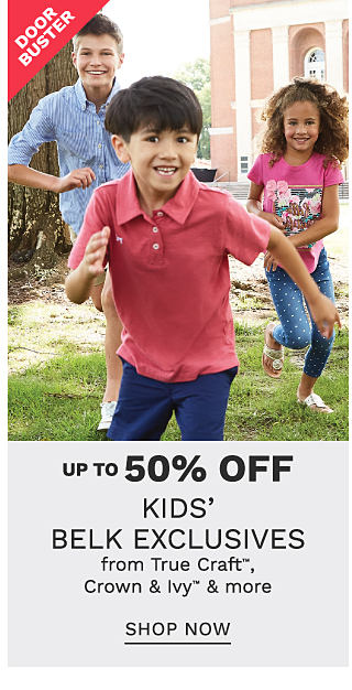 A boy wearing a light blue long sleeved button front shirt, beige shorts & white sneakers running with a boy wearing a coral polo & blue shorts & a girl wearing a pink tee with a multi colored front graphic, blue pants with white dots & sandals. DoorBuster. Up to 50% off kids Belk exclusives from True Craft, Crown & Ivy & more. Shop now.