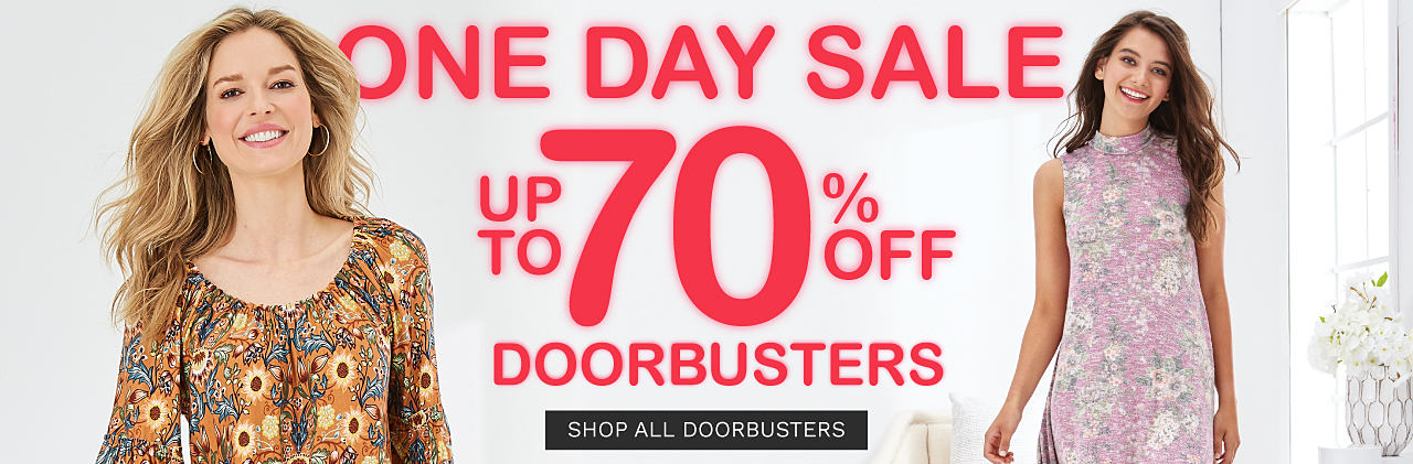 A woman wearing a multi colored print short sleeved top. A woman wearing a multi colored floral print sleeveless dress. One Day Sale DoorBusters. Up to 70% off. Shop all DoorBusters.