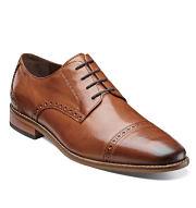 A brown leather men's dress shoe. Shop dress shoes.