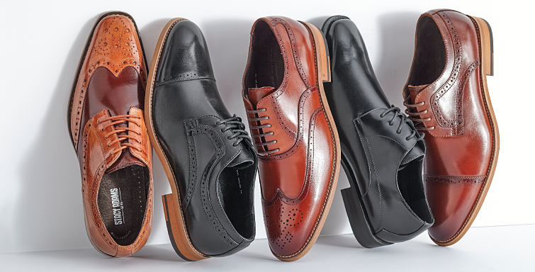An assortment of men's black and brown leather dress shoes.