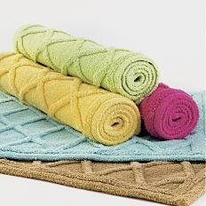 2 bath mats laid out flat on top of one another and 3 rolled bath mats on top. Shop bath rugs and mats.