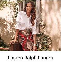 A woman wears a white button up top and a red skirt with an Aztec pattern. Lauren Ralph Lauren.