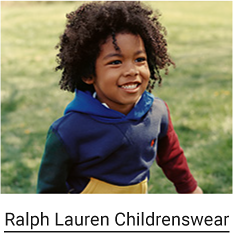 A boy wears a Ralph Lauren hoodie in blue, green, red and yellow. Ralph Lauren Childrenswear.