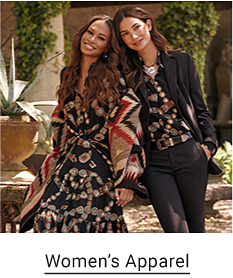 A woman in a black, red and blue dress with an Aztec inspired shawl, and another woman with shirt in the same print tucked into black dress pants with a black sport coat over top. Women's apparel.