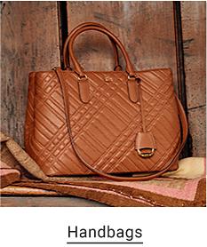 A brown leather handbag. Handbags.