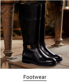 A pair of black rain boots with gold Ralph Lauren logos. Footwear