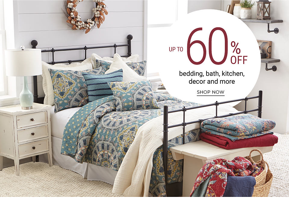 A bed made with a multi-colored pattern comforter and matching pillows. Up to 60% off bedding, bath, kitchen, decor & more.